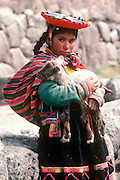 PERU, PORTRAITS a young Quechua girl and her lamb at Tambo Machay, the ancient Incan Royal Baths near  Cuzco