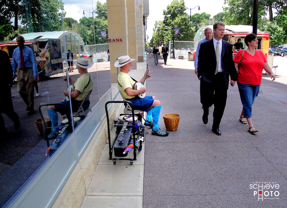 A street musician entertains the lunch-time crowd on Madison, Wisconsin's Capitol Square.