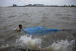 May 3, 2019 - Khulna, Bangladesh - 03 May 2019, Khulna, Bangladesh - A boy catches fish in the rough river as Cyclone Fani hits northeastwards into West Bengal state and towards Bangladesh. (Credit Image: © KM Asad/ZUMA Wire)