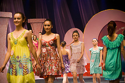 """Young women participate in """"Miss. International"""" beauty contest in Beijing, China, Nov. 7, 2009."""