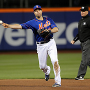 NEW YORK, NEW YORK - APRIL 11: Second baseman Neil Walker, New York Mets, makes an out during the Miami Marlins Vs New York Mets MLB regular season ball game at Citi Field on April 11, 2016 in New York City. (Photo by Tim Clayton/Corbis via Getty Images)