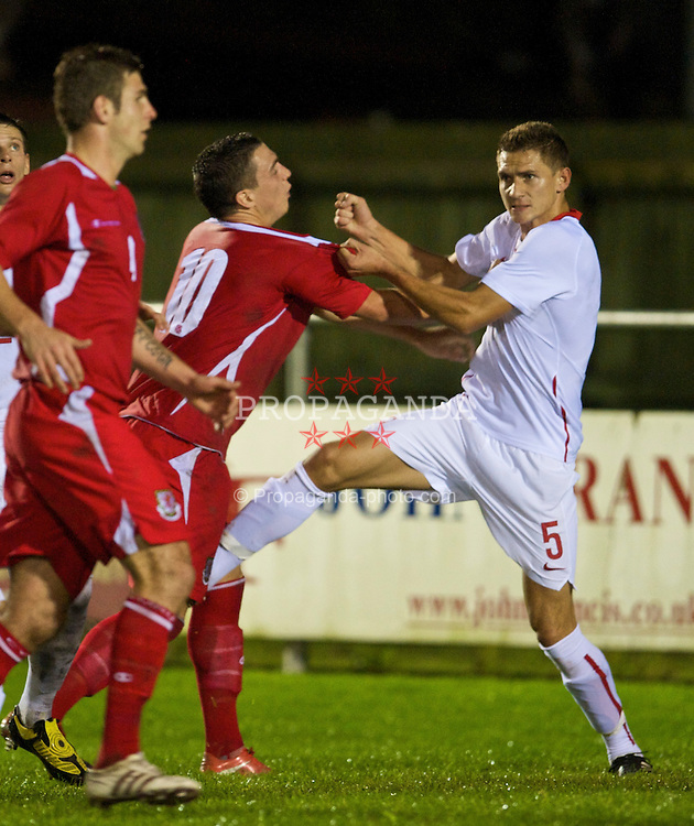 CAMARTHEN, WALES - Tuesday, September 8, 2009: Poland's Artur Jedrzejczyk punches Craig Moses, a penalty was awarded by the referee, during the Under-23 Semi-Professional friendly match at Richmond Park. (Pic by David Rawcliffe/Propaganda)