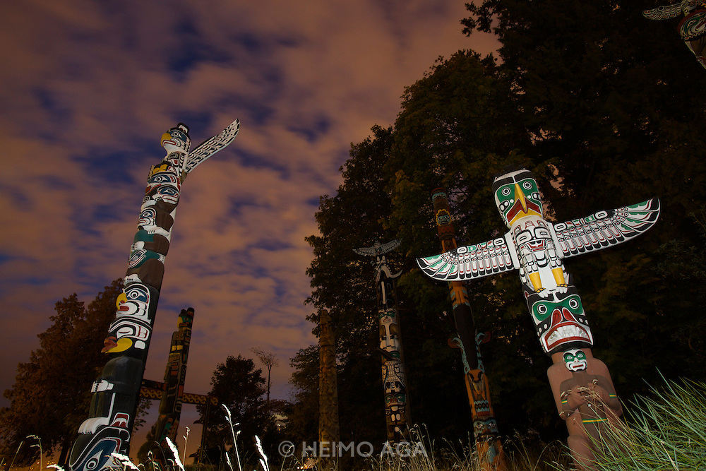 Totem Poles against an eerie evening sky at Stanley Park.