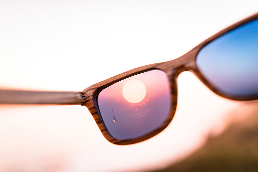 Sunglasses at sunset on the Pacific Ocean