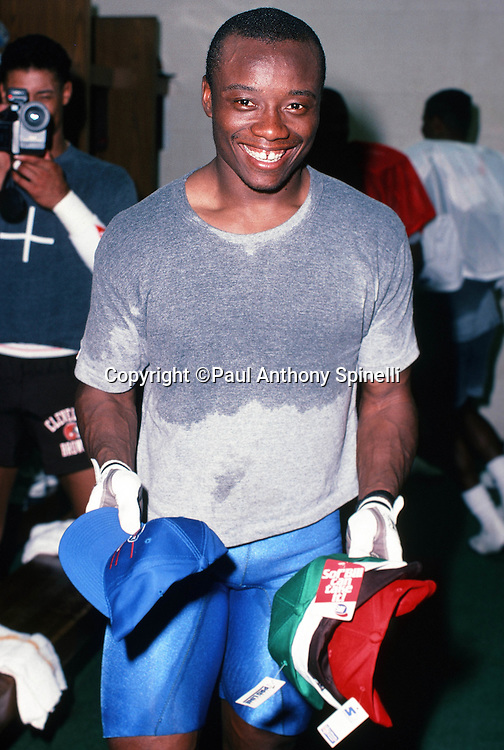 Cleveland Browns defensive back Frank Minnifield cools off in the locker room after working up a sweat and wearing a soaked t-shirt after practice during the week of the 1990 NFL Pro Bowl between the National Football Conference and the American Football Conference on Jan. 30, 1990 in Honolulu. The NFC won the game 27-21. (©Paul Anthony Spinelli)