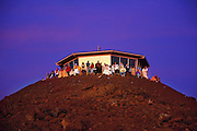 Observers watching sunrise at Haleakala summit. Haleakala National Park, Maui, Hawaii. USA.