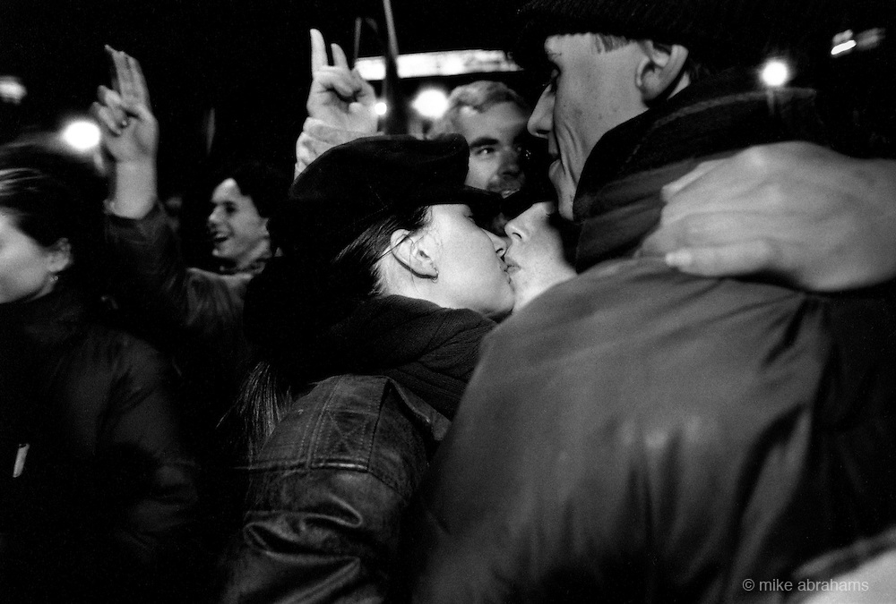 The Velvet Revolution.Two women kiss while celebrating the collapse of Communism in Czechoslovakia. Wenceslas Square, Prague. 24th November 1989
