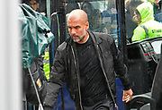 Manchester City manager Pep Guardiola arriving at the City of Cardiff Stadium in the rain during the Premier League match between Cardiff City and Manchester City at the Cardiff City Stadium, Cardiff, Wales on 22 September 2018.