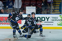 KELOWNA, CANADA - DECEMBER 30: Tyler Soy #17 pats Chaz Reddekopp #29 of the Victoria Royals on the back in response to a fan sign on the glass during warm up against the Kelowna Rockets on December 30, 2017 at Prospera Place in Kelowna, British Columbia, Canada.  (Photo by Marissa Baecker/Shoot the Breeze)  *** Local Caption ***
