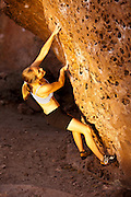 Climber Beth Rodden bouldering at the Happy Boulders near Bishop California, USA.