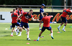 England's Phil Jones (left) and Alex Oxlade-Chamberlain (right) during the training session at Stade Omnisport.