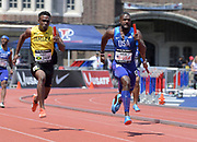 Apr 28, 2018; Philadelphia, PA, USA; Justin Gatlin (USA) and Tyquendo Tracey (JAM) run in the USA vs. The World 4 x 100m relay during the 124th Penn Relays at Franklin Field. USA won in 38.39 and Jamaica was third in 39.37.