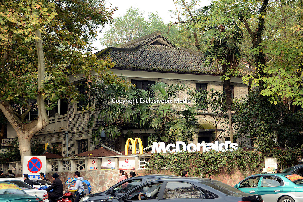 HANGZHOU, CHINA - NOVEMBER 15: (CHINA OUT) <br /> <br /> Chiang Ching-kuos Former Residence Turns Into A McDonalds<br /> <br /> McDonalds opens in Chiang Ching-kuos villa near West Lake on November 15, 2015 in Hangzhou, Zhejiang Province of China. Former Taiwan leader Chiang Ching-kuo, son of former Kuomintang leader Chiang Kai-shek, lived with his family in this two-story villa built in 1931 from the end of the War of Resistance against Japanese Aggression (1937-45) until they left for Taiwan in 1949. Two months earlier a Starbucks outlet opened in the side wing of the same house, the report said and now it still open a McDonald's in this historical villa. Controversy goes about in public that the old residence turning into a commercial place would go against the preservation of the historical site<br /> &copy;Exclusivepix Media