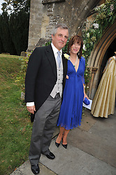 VISCOUNT & VISCOUNTESS ASTOR at the wedding of Lohralee Stutz and the Hon.William Astor at St.Augustine's Church, East Hendred, Oxfordshire on 5th September 2009.