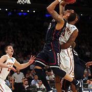 Shabazz Napier, UConn, drives to the basket while challenged by Monte Morris, Iowa, during the Iowa State Cyclones Vs Connecticut Huskies basketball game during the 2014 NCAA Division 1 Men's Basketball Championship, East Regional at Madison Square Garden, New York, USA. 28th March 2014. Photo Tim Clayton