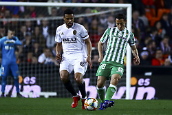 February 28, 2019 - Valencia, Spain - Francis Coquelin of Valencia CF (L) and Guardado  of Real Betis Balompi During Spanish King La Copa match between  Valencia cf vs Real Betis Balompie Second leg  at Mestalla Stadium on February 28, 2019. (Photo by Jose Miguel Fernandez/NurPhoto) (Credit Image: © Jose Miguel Fernandez/NurPhoto via ZUMA Press)
