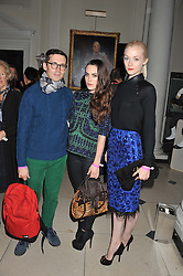 Left to right, ERDEM MORALIOGLU, TALULLAH HARLECH  and PORTIA FREEMAN at a private view of Story Teller by photographer Tim Walker supported by Mulberry held at Somerset House, The Strand, London on 17th October 2012.