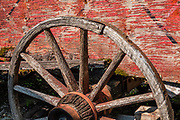 Old wagon wheel. Fort Nelson Heritage Museum, 5553 Alaska Highway, Fort Nelson, British Columbia, Canada. This quirky museum features a highway construction display, pioneer artifacts, trapper's cabin, vintage autos & machinery, a white moose, and more.