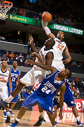 Virginia forward Mike Scott (32) grabs a one handed rebound against Hampton.  The Virginia Cavaliers defeated the Hampton Pirates 74-48 at the John Paul Jones Arena on the Grounds of the University of Virginia in Charlottesville, VA on December 23, 2008. (Special to the Daily Progress / Jason O. Watson)