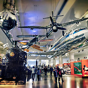 The transportation gallery exhibit at the Museum of Science and Industry in Chicago, IL includes a United Airlines Boeing 727, Piccard Gondola, 999 Steam Locomotive, smaller smaller aircraft and more. Photo by Jennifer Rondinelli Reilly. All Rights Reserved. No use without permission.