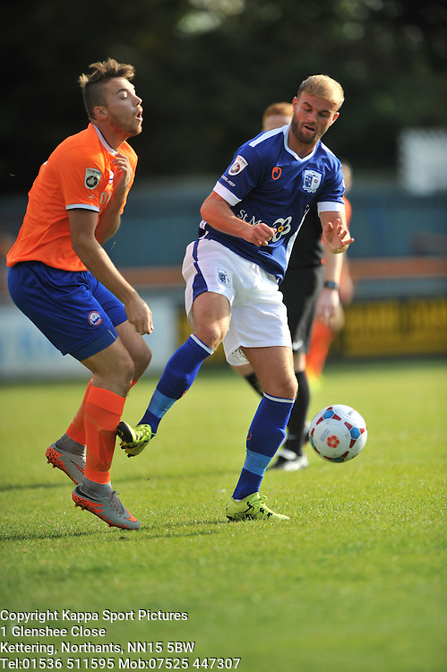 Barrows Niall Cowperthwaite fouls Braintree Jordan Chiedozie, Braintree Town v Barrow AFC, Avanti Stadium Braintree, Vanarama National League, Saturday, 12th September 2015.