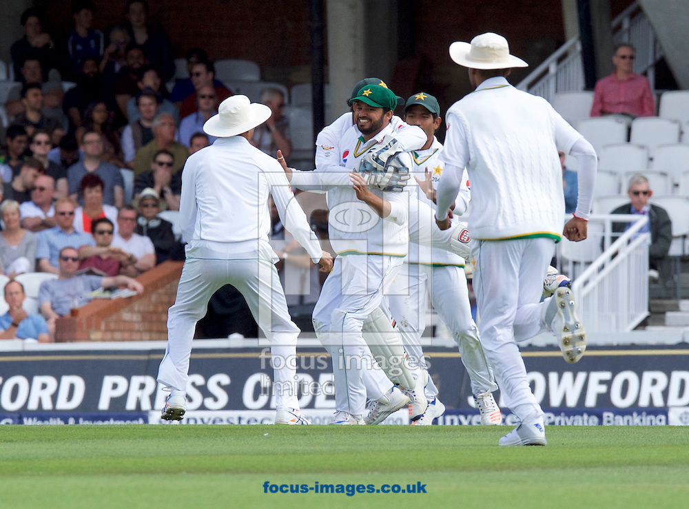 Azhar Ali of Pakistan celebrates catching Jonny Bairstow of England with Wicketkeeper Sarfraz Ahmed of Pakistan during Day Four of the fourth Investec Test Match at the Kia Oval, London<br /> Picture by Alan Stanford/Focus Images Ltd +44 7915 056117<br /> 14/08/2016
