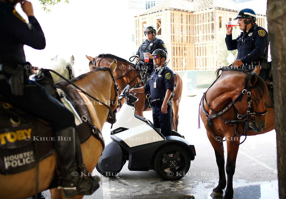 Houston Police Department officers on their various modes of transportation outside Minute Maid Park July 12, 2018, in Houston, TX.<br /> <br /> Photo by Khue Bui