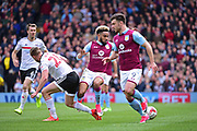 Aston Villa defender Jordan Amavi (23) in action with Aston Villa forward Scott Hogan (9) during the EFL Sky Bet Championship match between Fulham and Aston Villa at Craven Cottage, London, England on 17 April 2017. Photo by Jon Bromley.