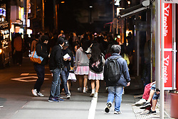 November 11, 2018 - Akihabara, Tokyo, Japan - Tokyo Japan - A group of teanager walk around the street of Akihabara passing out flyers on November, 11 2018. Akihabara is well known for its large number of Maid cafes in which staff members are usually female teenagers. According to some local media reports a recent survey by the Japan Minister of Education shows ''Japan youth suicide rate highest in 30 years''. Photo by: Ramiro Agustin Vargas Tabares (Credit Image: © Ramiro Agustin Vargas Tabares/ZUMA Wire)