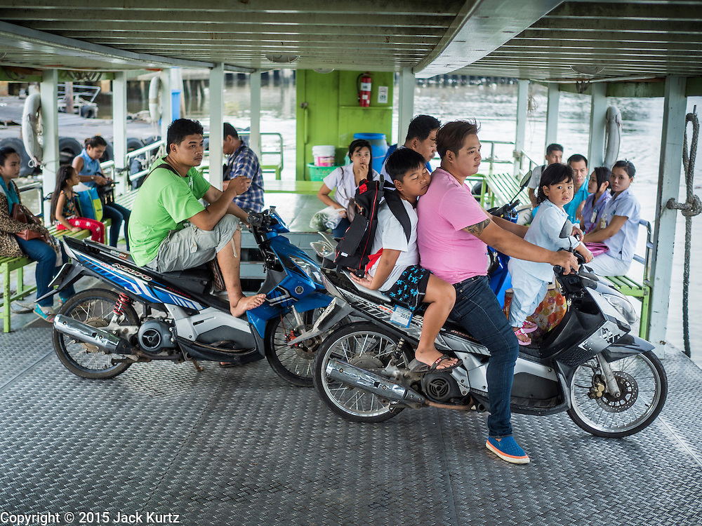 13 MAY 2015 - MAHACHAI, SAMUT SAKHON, THAILAND: Passengers on a ferry crossing the Tha Chin river in Mahachai, Samut Sakhon, Thailand.  PHOTO BY JACK KURTZ