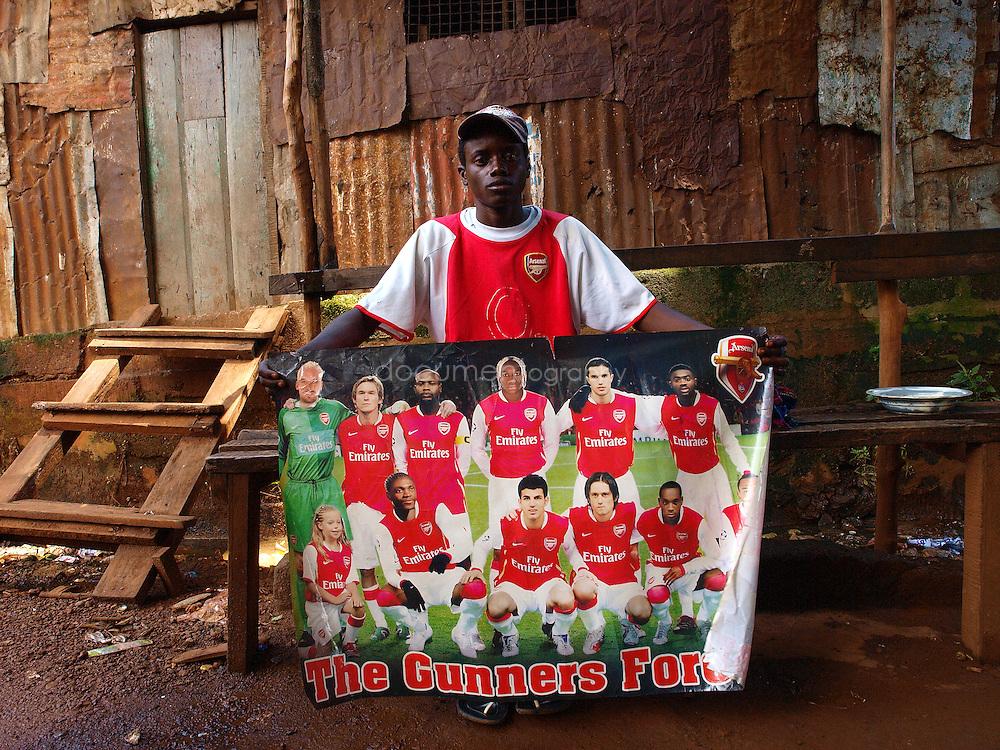 An Arsenal fan, Kroo Bay, Freetown, Sierra Leone