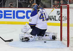 Feb 9; Newark, NJ, USA; New Jersey Devils center Adam Henrique (14) scores a goal on St. Louis Blues goalie Jaroslav Halak (41) during the second period at the Prudential Center.