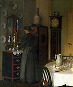 Tea Time', 1898. Oil on canvas. Valdemar Kornerup (1865-1924) Danish painter. Woman in grey filling pot with hot water from kettle. Domestic Interior Dining Table Linen Screen Clock  Mirror