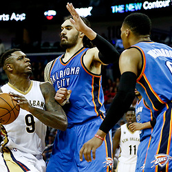 Jan 25, 2017; New Orleans, LA, USA; New Orleans Pelicans forward Terrence Jones (9) drives in against Oklahoma City Thunder center Steven Adams (12) and guard Russell Westbrook (0) during the second half of a game at the Smoothie King Center. The Thunder defeated the Pelicans 114-105. Mandatory Credit: Derick E. Hingle-USA TODAY Sports
