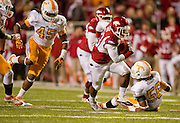 Nov 12, 2011; Fayetteville, AR, USA; Arkansas Razorback running back De'Anthony Curtis (23) gets past Tennessee Volunteers defensive linemen Curt Maggitt (56) and linebacker A.J. Johnson (45) looks on during the second half at Donald W. Reynolds Razorback Stadium. Arkansas defeated Tennessee 49-7. Mandatory Credit: Beth Hall-US PRESSWIRE