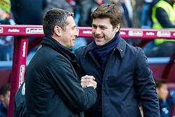 Tottenham Hotspur Manager Mauricio Pochettino is greeted by Aston Villa Manager Remi Garde - Mandatory byline: Rogan Thomson/JMP - 13/03/2016 - FOOTBALL - Villa Park Stadium - Birmingham, England - Aston Villa v Tottenham Hotspur - Barclays Premier League.
