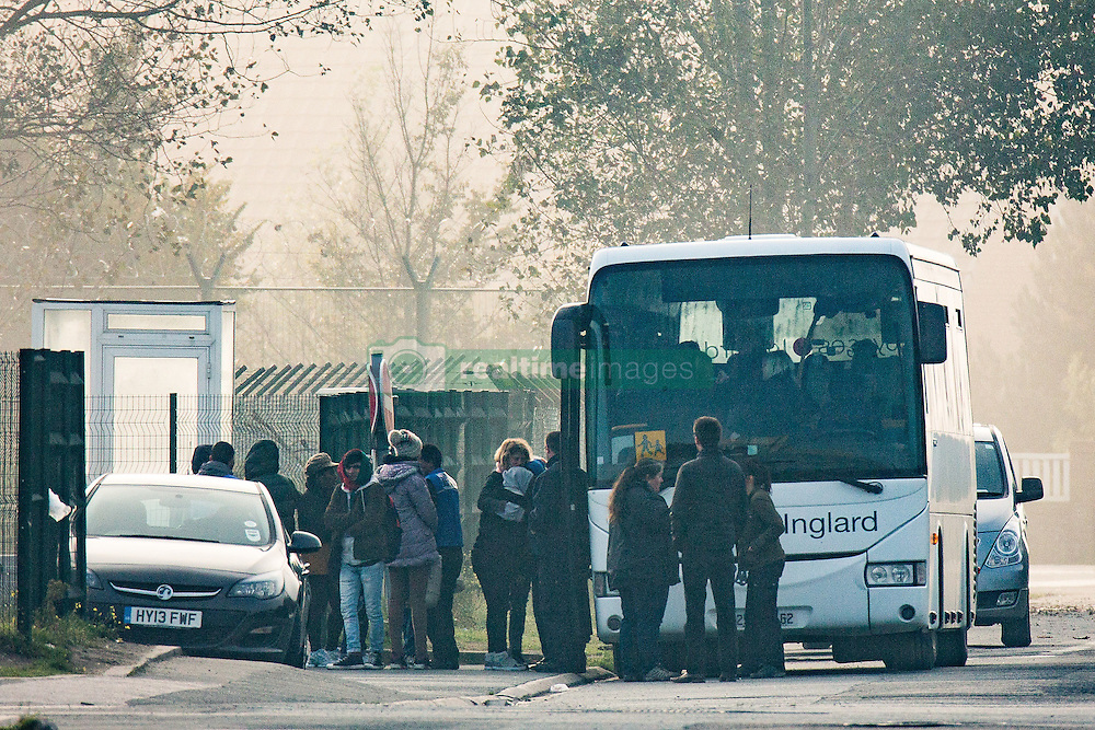 October 23, 2016 - Calais, Calais, France - Calais , France . People queuing by a coach , from where migrants are being relocated from the camp . Dawn at the Calais migrant camp known as '' The Jungle '' , in Northern France , on the final day before the eviction and destruction of the camp  (Credit Image: © Joel Goodman/London News Pictures via ZUMA Wire)