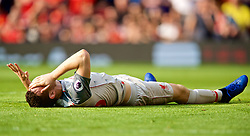 MANCHESTER, ENGLAND - Sunday, February 24, 2019: Liverpool's Andy Robertson lies injured during the FA Premier League match between Manchester United FC and Liverpool FC at Old Trafford. (Pic by David Rawcliffe/Propaganda)