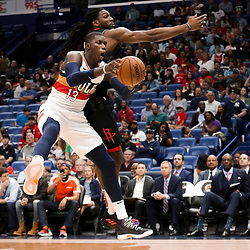 Mar 24, 2019; New Orleans, LA, USA; New Orleans Pelicans forward Cheick Diallo (13) rebounds over Houston Rockets forward Kenneth Faried (35) during the first quarter at the Smoothie King Center. Mandatory Credit: Derick E. Hingle-USA TODAY Sports