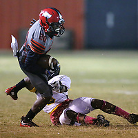 Lauren Wood | Buy at photos.djournal.com<br /> Shannon's Javis Wren is tripped up by Itawamba's Colbe Hodges during Friday night's game at Shannon.