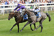 DELPH CRESCENT (10) ridden by jockey Paul Hanagan(near side)  and trained by Richard Fahey wins the The Acturis Handicap Stakes over 1m 2f (£16,600) in a photograph finish from THOMAS CRANMER (1) ridden by Rowan Scottat York Racecourse, York, United Kingdom on 13 July 2018. Picture by Mick Atkins.