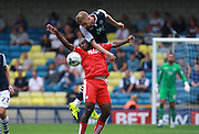 Chesterfield player Sylvan Ebanks-Blake and Millwall player Mark Beevers fight for a high ball during the Sky Bet League 1 match between Millwall and Chesterfield at The Den, London, England on 29 August 2015. Photo by Bennett Dean.