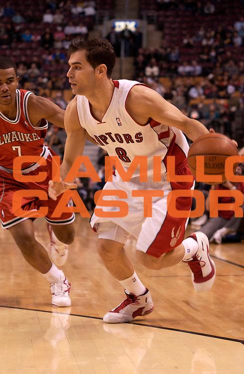 DESCRIZIONE : Toronto Campionato NBA 2008-2009 Toronto Raptors Milawaukee Bucks<br /> GIOCATORE : Jose Calderon<br /> SQUADRA : Toronto Raptors<br /> EVENTO : Campionato NBA 2008-2009 <br /> GARA : Toronto Raptors Milawaukee Bucks<br /> DATA : 25/03/2009<br /> CATEGORIA : <br /> SPORT : Pallacanestro <br /> AUTORE : Agenzia Ciamillo-Castoria/V.Keslassy<br /> Galleria : NBA 2008-2009<br /> Fotonotizia : Toronto Campionato NBA 2008-2009 Toronto Raptors Milawaukee Bucks<br /> Predefinita :