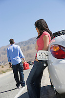Woman stays with car as man sets off for gasoline