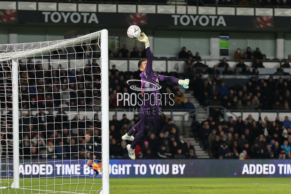 Manchester United goalkeeper Sergio Romero tips over a shot by Derby County midfielder/coach Wayne Rooney   during the The FA Cup match between Derby County and Manchester United at the Pride Park, Derby, England on 5 March 2020.