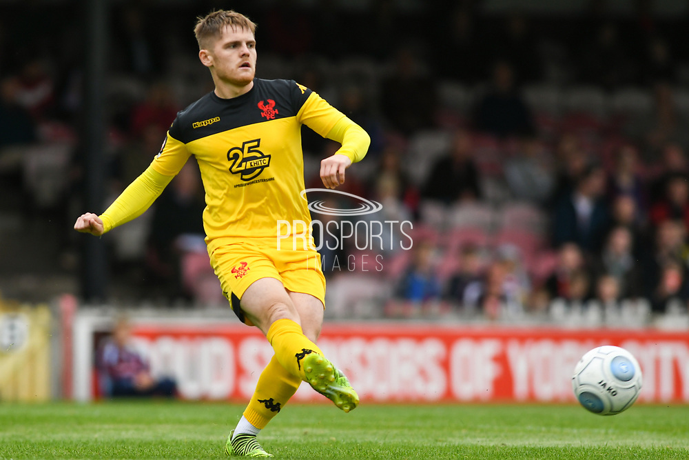 Declan Weeks of Kidderminster Harriers (7) passes the ball forward during the Vanarama National League match between York City and Kidderminster Harriers at Bootham Crescent, York, England on 15 September 2018.