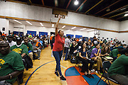 CASA member Madeline Mender chanting &ldquo;Si se puede!&rdquo; through the Latino Pastoral Action Center&rsquo;s packed auditorium on Wednesday October 21st.<br /> Photo by Emily Holzknecht