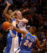 11-2--06 LOS ANGELES CA- Clippers Chris Kaman is fouled by a host of  Nuggets in the 3rd quarter..photo by John McCoy/staff photograper LA Daily News