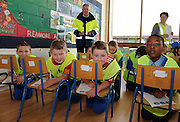 """Keep Safe"" road show comes to Galway school children .Over one hundred and twenty children have attended a 'Keep Safe' event in Scoil Chaitríona, Renmore, Co. Galway.  A range of state agencies and organisations came together to deliver the programme which is directed at 5th and 6th class pupils.  It aims to promote safety and community awareness through involving the children in a series of interactive scenarios with a strong safety theme. The ESB had these lads working hard.  Photo:Andrew Downes."