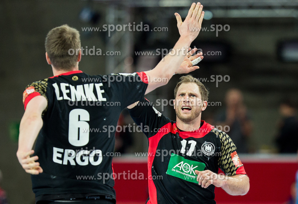 Finn Lemke of Germany and Steffen Weinhold of Germany celebrate during handball match between National teams of Germany and Slovenia on Day 6 in Preliminary Round of Men's EHF EURO 2016, on January 20, 2016 in Centennial Hall, Wroclaw, Poland. Photo by Vid Ponikvar / Sportida